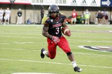 NIU running back Akeem Daniels runs downfield during the Huskies' 55-3 win over Presbyterian on Aug. 28, 2014. (RoadTripSports photo by Matthew Postins)
