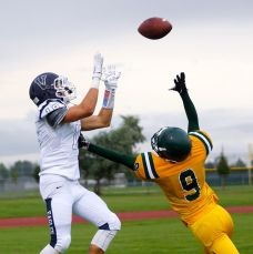 Players from Valor Christian and Bonneville fight for a football in their game at Idaho Falls, ID, on Aug. 22, 2013. (RoadTripSports photo by Kendall Webb)