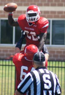 Navarro running back Ke'aun Kinner is lifted in the air by a teammate after celebrating a score against Georgia Military on Aug. 23, 2014, at Tiger Field in Corsicana, Texas. (RoadTripSports photo by Chuck Cox)