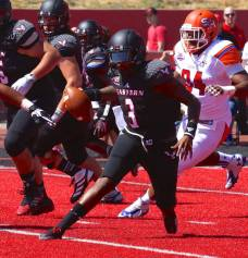 Eastern Washington quarterback Vernon Adams Jr. runs upfield during the Eagles' win over Sam Houston State on Aug. 23, 2014, in Cheney, WA. (RoadTripSports photo by Kendall Webb)