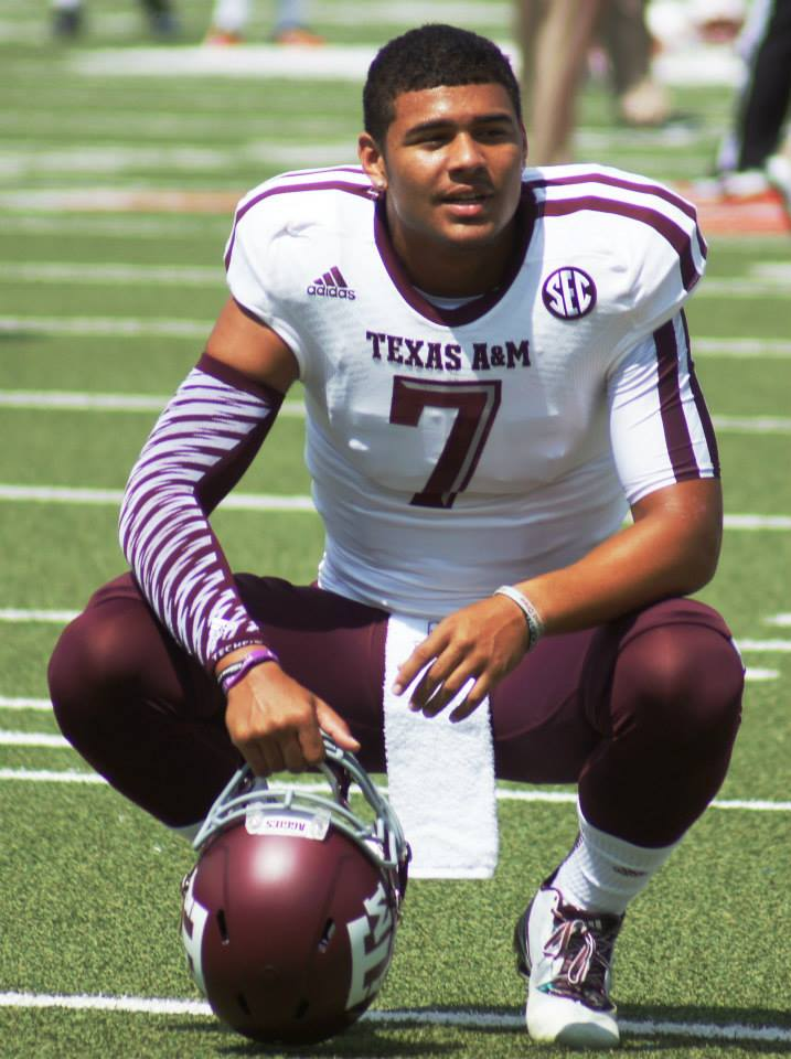 Texas A&M quarterback Kenny Hill pauses during pre-game warmups against SMU on Sept. 20, 2014. (RoadTripSports photo by Chuck Cox)