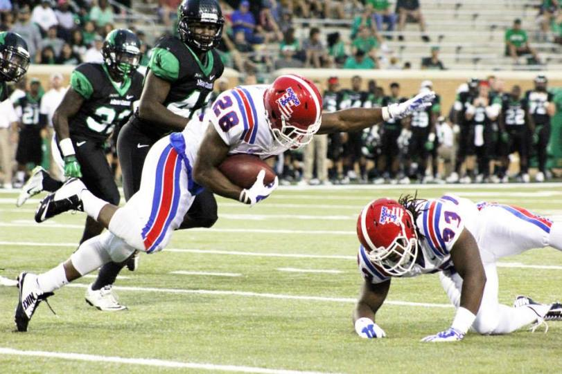 Louisiana Tech running back Kenneth Dixon (28) leans for yardage against North Texas on Sept. 11, 2014, in Denton, TX. (RoadTripSports photo by Matthew Postins)