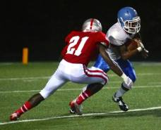 A Baylor School defender tries to tackle a Brainerd ball carrier during their game in Chattanooga, TN, on Sept. 12, 2014. (RoadTripSports photo by Kendall Webb)