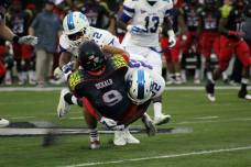Presbyterian linebacker Donelle Williams tackles NIU quarterback Matt McIntosh during their game in DeKalb, IL, on Aug. 28, 2014. (RoadTripSports photo by Matthew Postins)