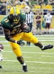 North Dakota State running back John Crockett carries the football during NDSU's game with Montana on Sept. 20, 2014. (RoadTripSports photo by Matthew Postins)