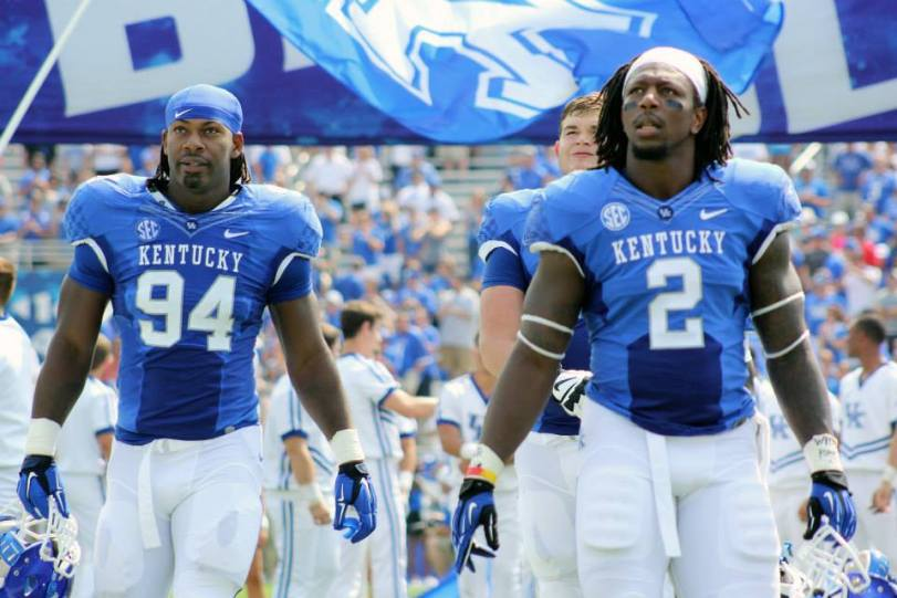 Kentucky defenders Za'Darius Smith (left) and Bud Dupree prepare for the coin toss before Kentucky's game with UT Martin on Aug. 30, 2014. (RoadTripSports photo by Matthew Postins)