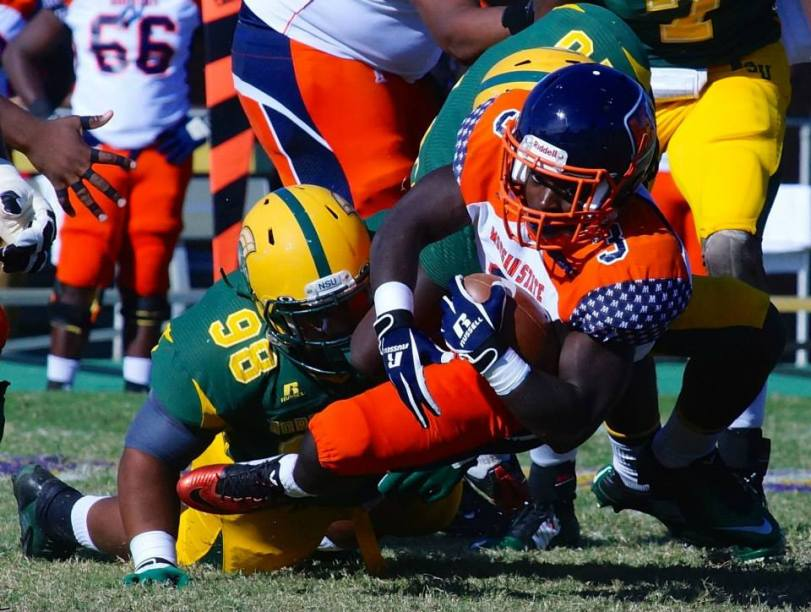 Morgan State running back Herb Walker Jr. (right) is brought to the ground by Norfolk State defensive lineman Shawn Fauntleroy Jr. during their game on Sept. 27, 2014, in Norfolk, VA. (RoadTripSports photo by Kendall Webb)