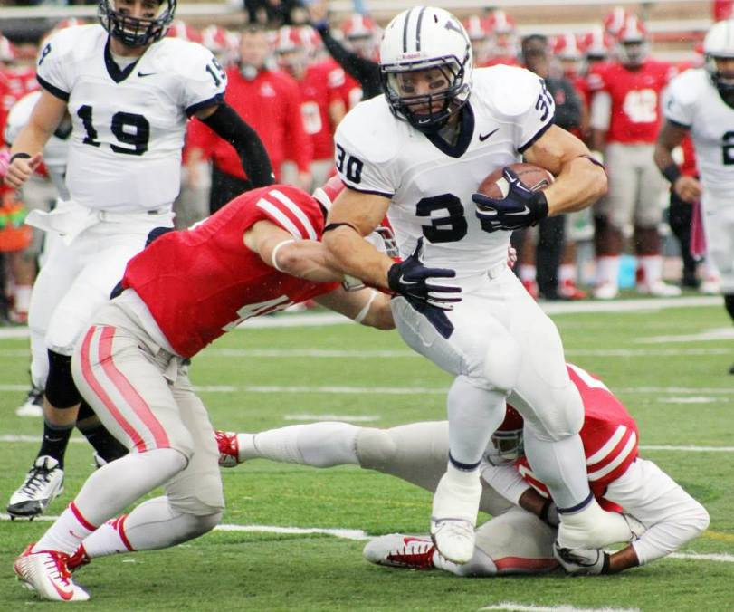 Yale running back Tyler Varga tries to elude two Cornell defenders during their game in Ithaca, NY, on Oct. 4, 2014. (RoadTripSports photo by Matthew Postins)