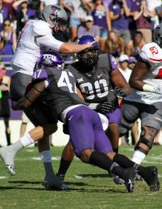 TCU linebacker Paul Dawson sacks Tech Tech quarterback Davis Webb (left) during their game at Amon G. Carter Stadium in Fort Worth, TX, on Oct. 25, 2014. (RoadTripSports photo by Matthew Postins)