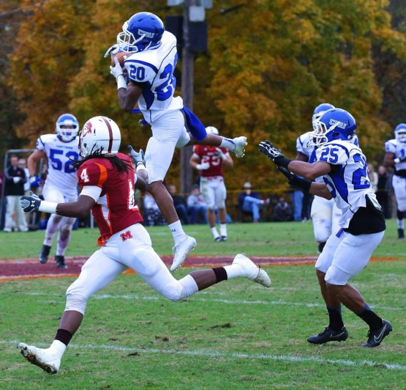 Christopher Newport defensive back Shomari Wright (center) leaps up to intercept a pass against Maryville (TN). (RoadTripSports photo by Kendall Webb)