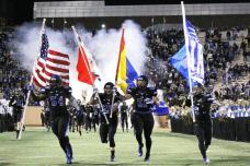 Duke players run onto the field during pregame festivities against North Carolina on Nov. 20, 2014. (RoadTripSports photo by Matthew Postins)