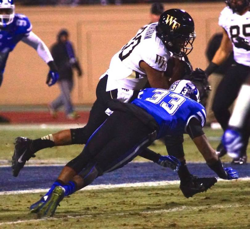Duke safety Deondre Singleton tries to bring down a Wake Forest ball carrier at Wallace Wade Stadium on Nov. 29, 2014. (RoadTripSports photo by Kendall Webb)