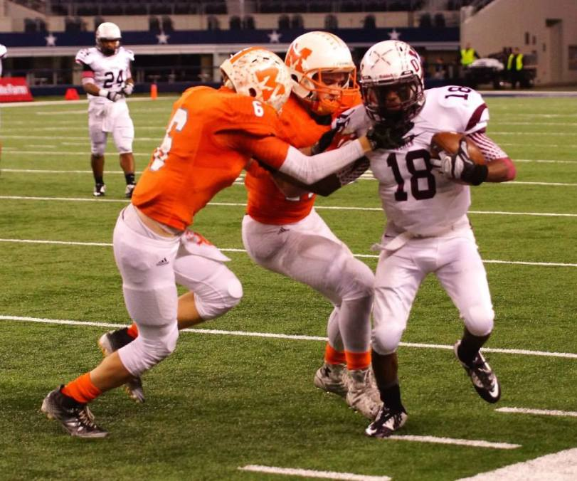 Players from Mineola and Cameron Yoe square off in the Texas UIL Class 3A Division I state championship game at AT&T Stadium in Arlington, Texas. (RoadTripSports photo by Kendall Webb)
