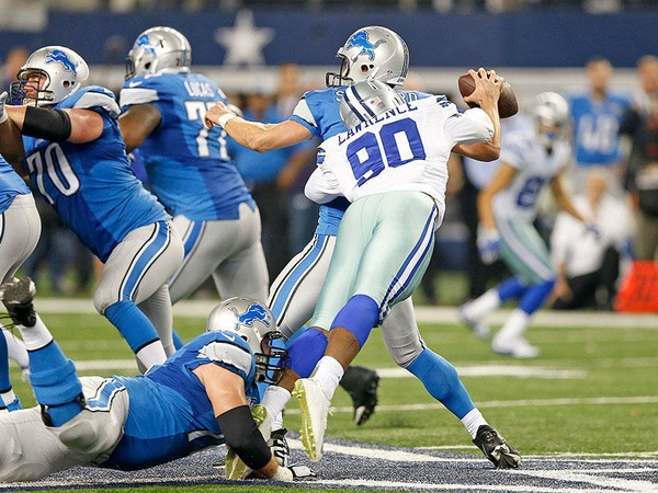 Cowboys defensive end Demarcus Lawrence sacks Lions quarterback Matthew Stafford during Sunday's NFC playoff game at AT&T Stadium.