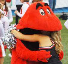 Big Red, the Western Kentucky mascot, swallows up a Hilltoppers cheerleader during their game with Middle Tennessee in 2014. (RoadTripSports photo by Chuck Cox)