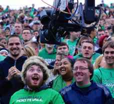 A Marshall fan mugs for the camera during a Thundering Herd game in 2014. (RoadTripSports photo by Kendall Webb)