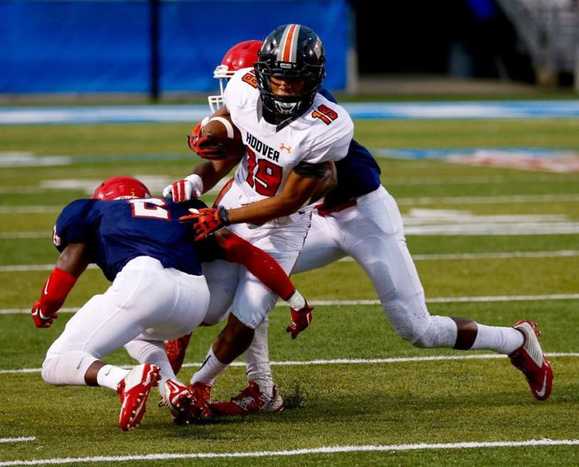 Players from Hoover (AL) and Oakland (TN) face off in the Middle Tennessee Football Classic on Aug. 22, 2015. (RoadTripSports photo by Kendall Webb)