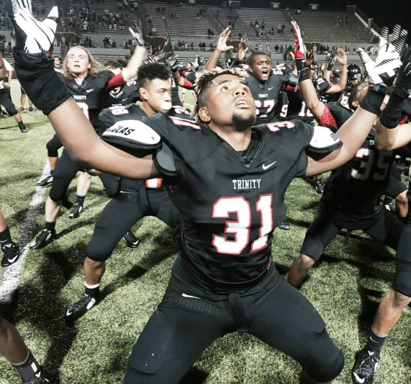 Euless Trinity players do the Haka Dance after their 26-21 win over De La Salle (CA) on Aug. 29, 2015, in Mansfield, Texas. (RoadTripSports photo by Chuck Cox)