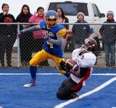 Players from Juneau-Douglas and Barrow during their contest in Barrow, Alaska, on Aug. 15, 2015. (RoadTripSports photo by Kendall Webb)