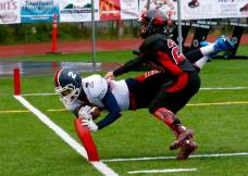 Players from North Pole and Juneau-Douglas during their contest on Aug. 19, 2015, in Juneau, Alaska. (RoadTripSports photo by Kendall Webb)