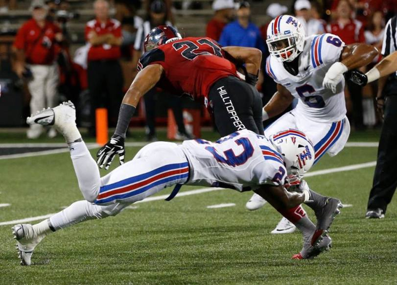 Players from Louisiana Tech (in white) and Western Kentucky during their contest on Sept. 10, 2015, in Bowling Green, Ken. (RoadTripSports photo by Kendall Webb)