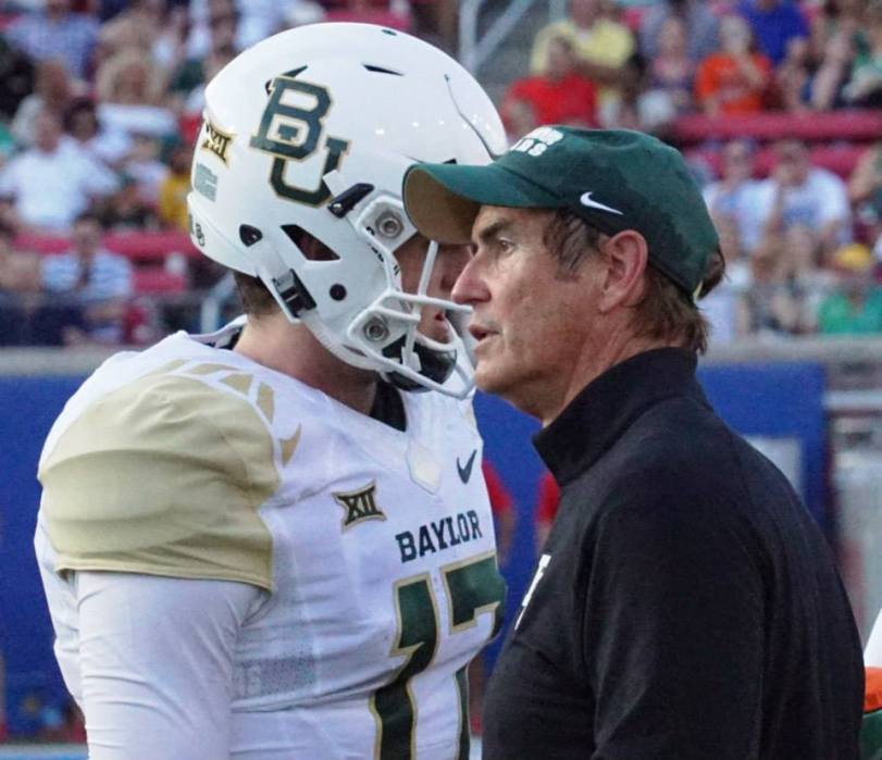 Baylor coach Art Briles (right) talks with quarterback Seth Russell during a break in the action against SMU on Sept. 4, 2015, in University Park, Texas. (RoadTripSports photo by Chuck Cox)