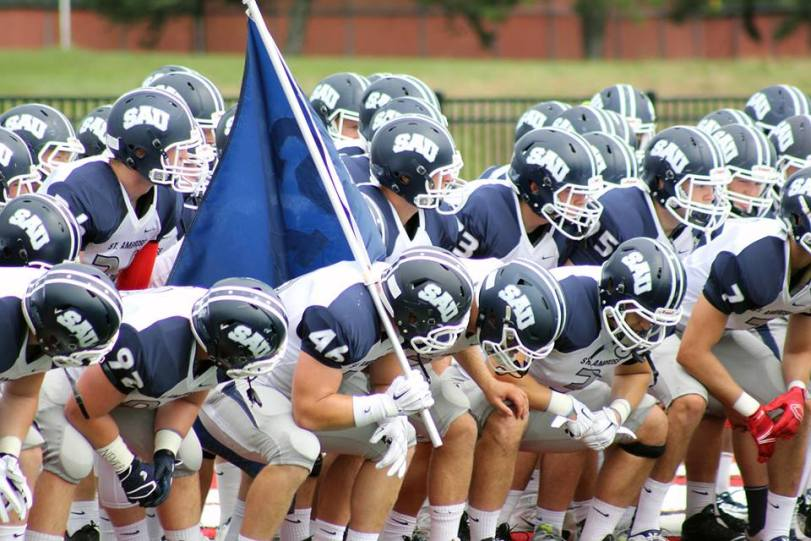 The St. Ambrose Fighting Bees prepare to take the field against Concordia (MI) during their game in Ann Arbor, Mich., on Sept. 5, 2015. (RoadTripSports photo by Matthew Postins)