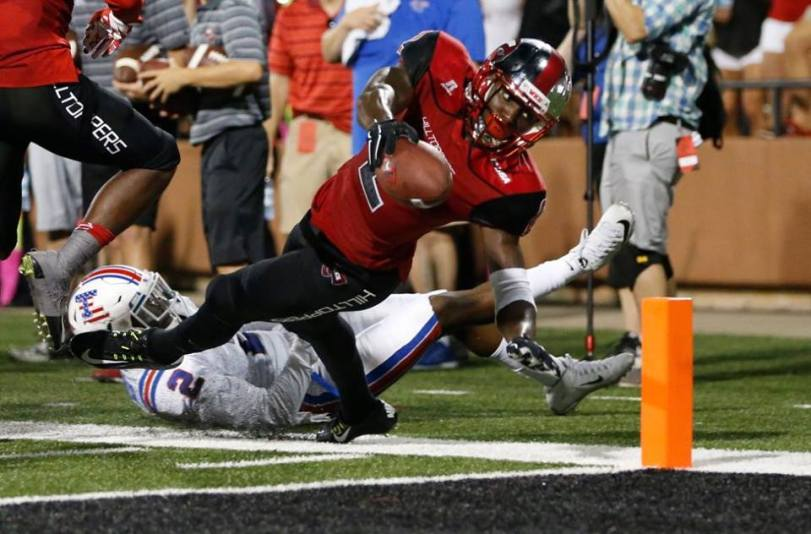 Western Kentucky wide receiver Taywan Taylor reaches for the goal line against Louisiana Tech on Sept. 10, 2015, in Bowling Green, Ken. (RoadTripSports photo by Kendall Webb)