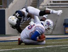 Akron defensive lineman Se'Von Pittman goes flying over a Savannah State ball carrier during their game in Akron, Ohio, on Sept. 19, 2015. (RoadTripSports photo by Kendall Webb)