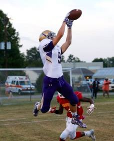 A receiver from Male High School (Louisville, KY) goes airborne for a pass as a Seneca (Louisville, KY) defender trails behind during their contest on Sept. 18, 2015. (RoadTripSports photo by Kendall Webb)