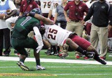 """MSU's Calvin Stewart (right) goes horizontal to try and bring down ENMU""""s Kamal Cass. (RoadTripSports photo by Matthew Postins)"""