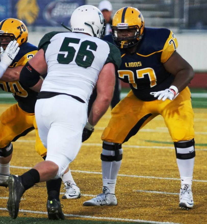 Texas A&M-Commerce offensive lineman Jordan Smith (right) prepares to set a block against Adams State on Sept. 3, 2015. (RoadTripSports photo by Chuck Cox)