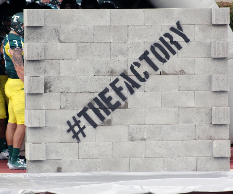Eastern Michigan players break through this wall before each game at Rynearson Stadium in Ypsilanti, Mich. (RoadTripSports photo by Matthew Postins)