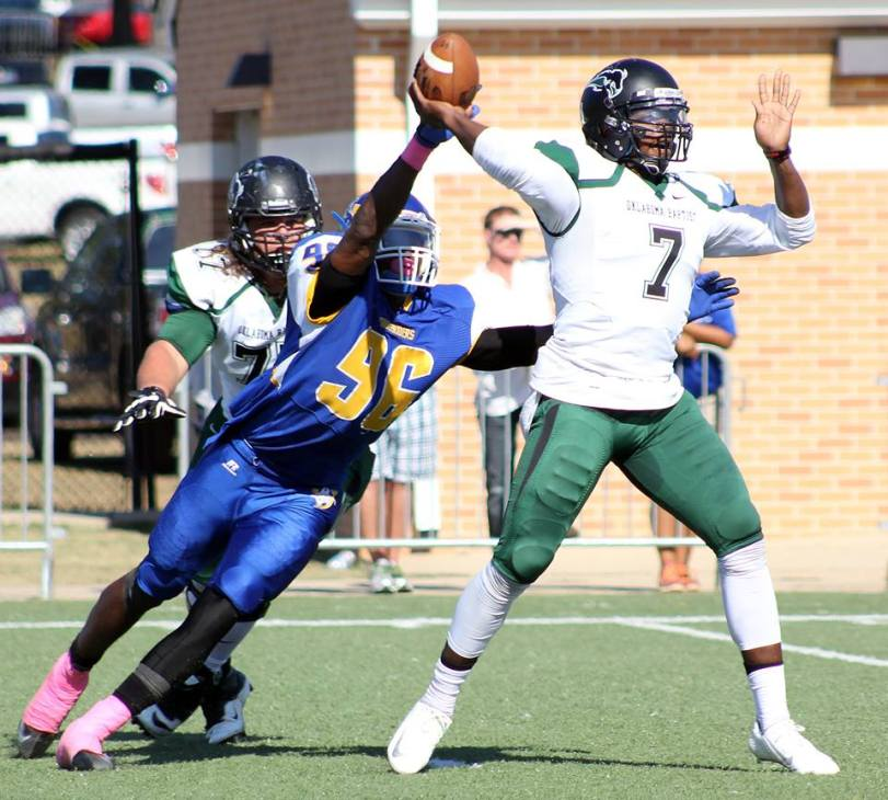 Oklahoma Baptist quarterback Dezmond Stegall throws a pass in the first half of his game with Southern Arkansas on Oct. 10, 2015. (RoadTripSports photo by Matthew Postins)