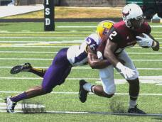 McMurray wide receiver Charles Agugua (right) tries to elude a Texas College tackler during their game on Sept. 19, 2015, in Tyler, Texas. (RoadTripSports photo by Chuck Cox)