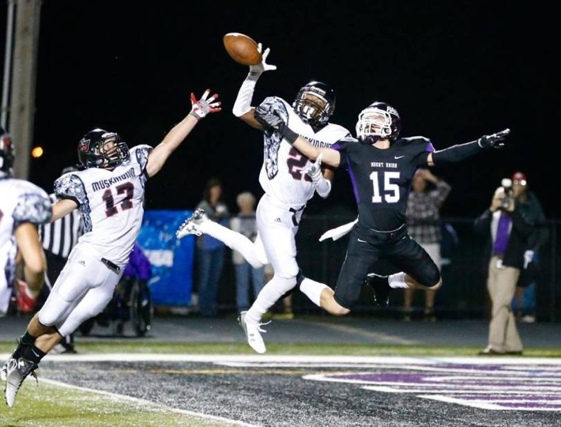 Mount Union wide receiver Braeden Friss (15) lunges for the football during the Purple Raiders' game with Muskingum on Sept. 19, 2015. (RoadTripSports photo by Kendall Webb)
