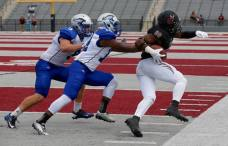 Lindenwood-Belleville wide receiver Walter Jackson (right) runs downfield as two Saint Francis Cougars are in pursuit during their game in Belleville, IL, on Sept. 26, 2015. (RoadTripSports photo by Kendall Webb)