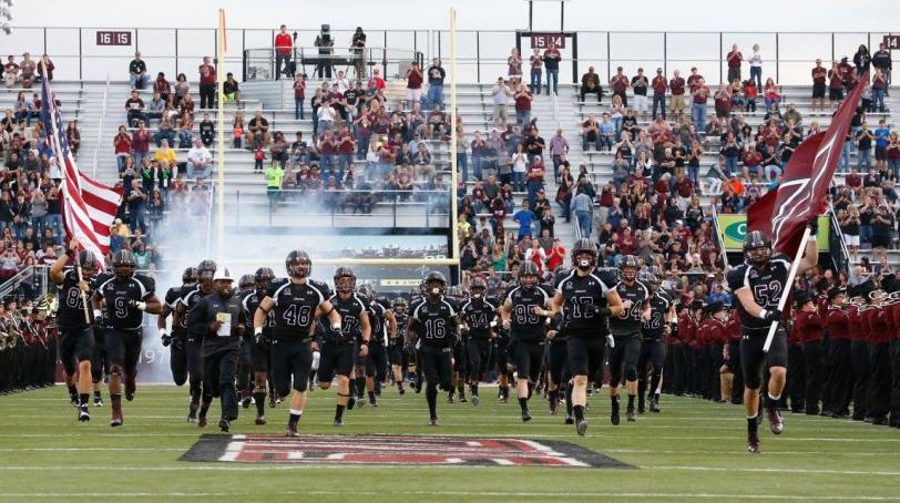 The Southern Illinois Salukies take the field before their game against Liberty on Sept. 26, 2015. (RoadTripSports photo by Kendall Webb)