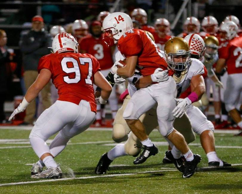 Center Grove senior RB Jackson Hohlt (red No. 14) scored the game's only touchdown. (RoadTripSports photo by Kendall Webb)