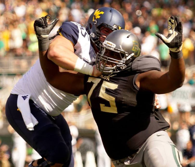Baylor's Andrew Billings seeks to get around a West Virginia offensive lineman during their game on Oct. 17, 2015, in Waco, Texas. (RoadTripSports photo by Chuck Cox)