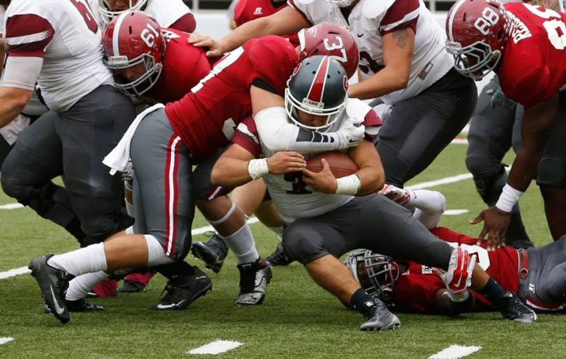 Henderson State's Lawson Schulz (left) tackles a Southern Nazarene ball carrier during their game on Oct. 31, 2015. (RoadTripSports photo by Kendall Webb)