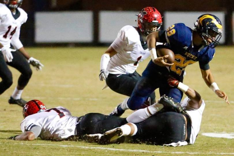 A Buckhorn Bucks player tries to elude the grasp of a Muscle Shoals player during their matchup on Oct. 29, 2015. (RoadTripSports photo by Kendall Webb)