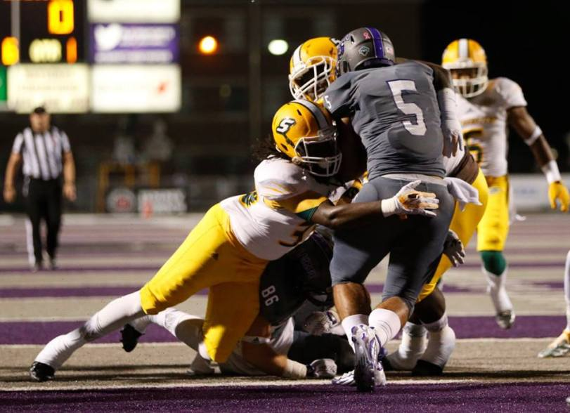 Defensive players for Southeastern Louisiana bring down Central Arkansas' Dominique Thomas during their game on Oct. 31, 2015. (RoadTripSports photo by Kendall Webb)