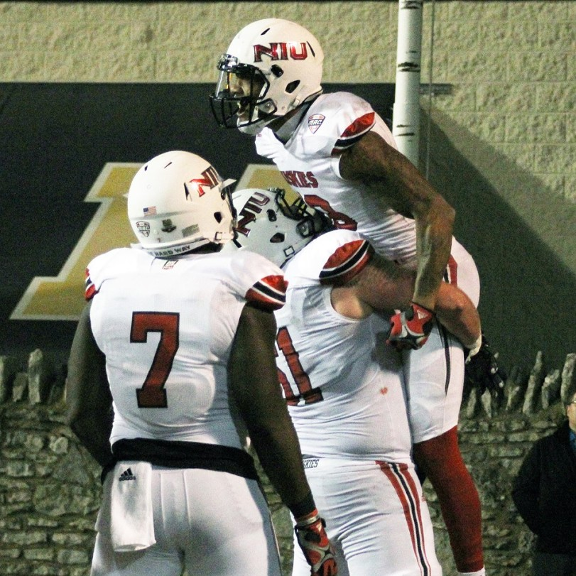 NIU's Kenny Golladay (top) celebrates with his teammates after a touchdown catch against Toledo on Nov. 3, 2015, in Toledo, OH. (RoadTripSports photo by Matthew Postins)