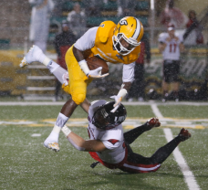 Southeastern Louisiana wide receiver Da'Quan Smith goes airborne to avoid an Incarnate Word defender on Nov. 7, 2015. (RoadTripSports photo by Kendall Webb)
