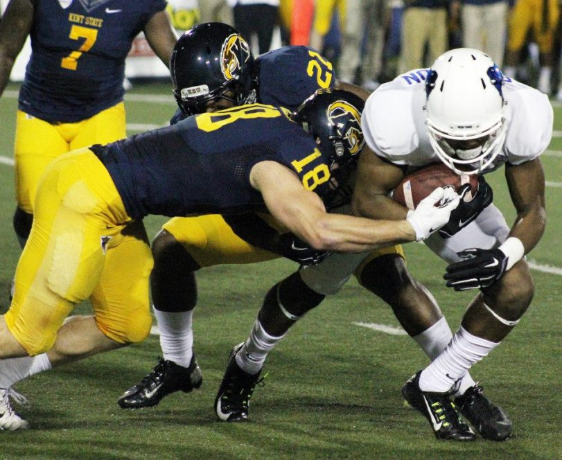 Kent State's Nate Holley (left) brings down this Buffalo ball carrier on Nov. 5, 2015. (RoadTripSports photo by Matthew Postins)