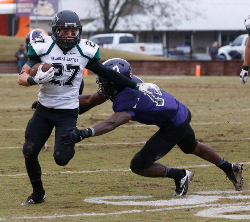 Oklahoma Baptist's Jacob Ellis runs the ball against Ouachita Baptist on Oct. 31, 2015. (RoadTripSports photo by Kendall Webb)